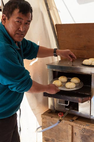 Mani baking fresh rolls at Everest BC with our gas oven
