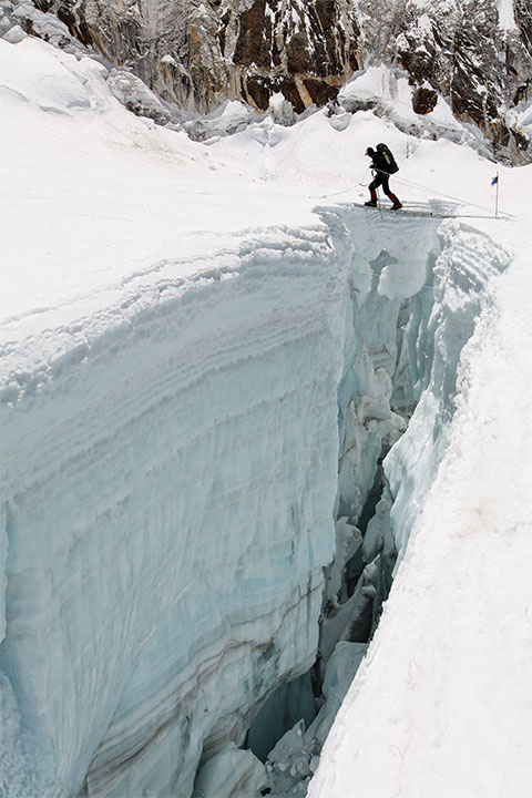 Andy Faltage crosses a crevasse